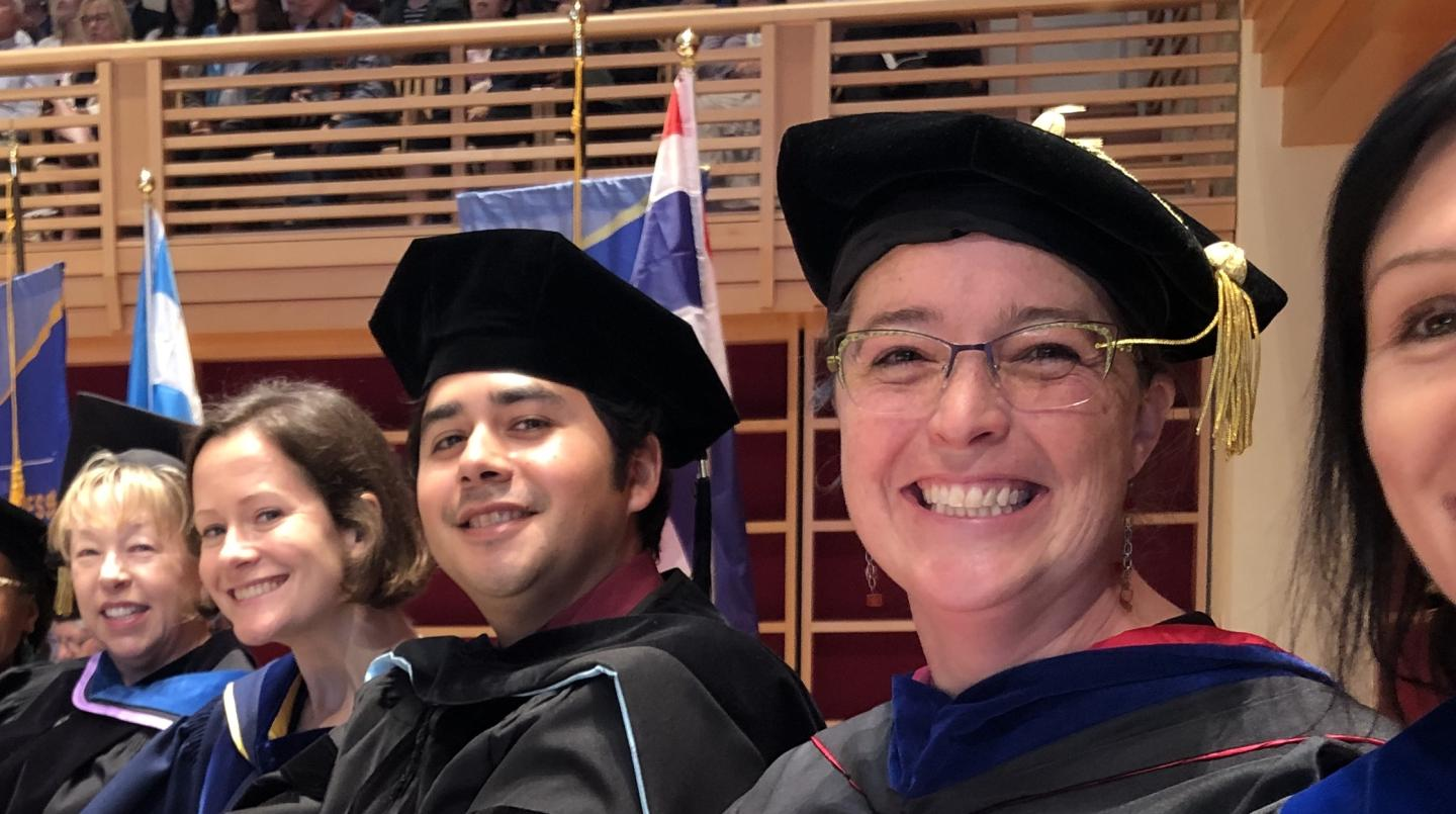 Faculty cheer on graduates at commencement