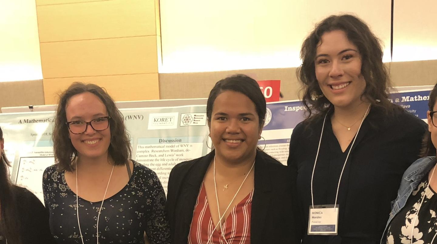 Students presenting their research at a conference